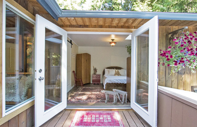French doors open off the sunny bedroom