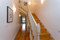 stairs up, breeze way to master bedroom